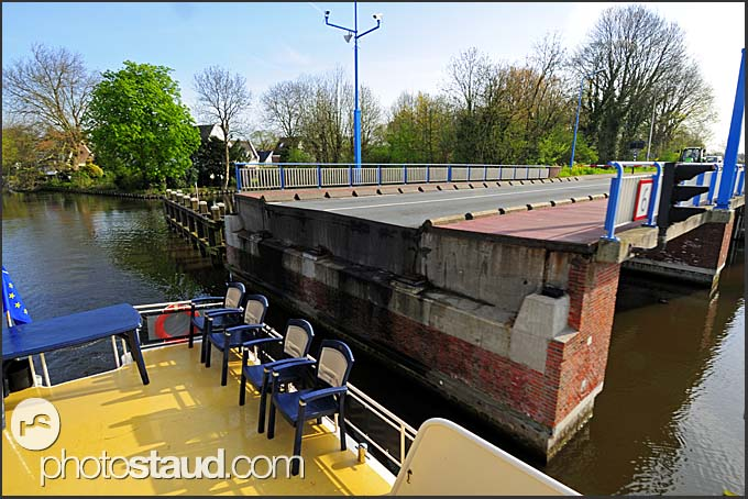 Yacht passing through open bridge on Dutch canal, Holland, Europe