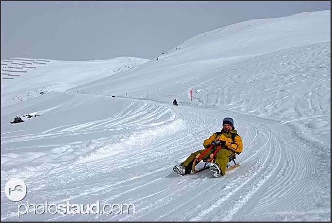 Sledging down the slopes of Chandolin, Switzerland, Europe