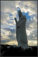 Gigantic Buddhist statue of the bodhisattva Dai-Kannon at sunset, Sendai, Japan