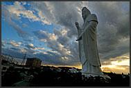Heavy clouds above Gigantic Buddhist statue of the bodhisattva Dai-Kannon, Sendai, Japan