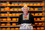 Ria Out in front of shelf of cheese at traditional Dutch farm, Alida Hoeve in Volendam, Holland, Europe