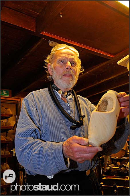 Shoemaker Ben van Woensel posing with wooden clog at De Vriendschap in Volendam, Holland, Europe