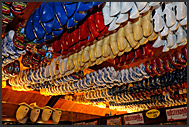 Wooden shoes hanging in souvenir shop at De Vriendschap in Volendam, Holland, Europe