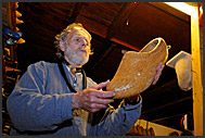 Shoemaker Ben van Woensel shows wooden clog at De Vriendschap in Volendam, Holland, Europe