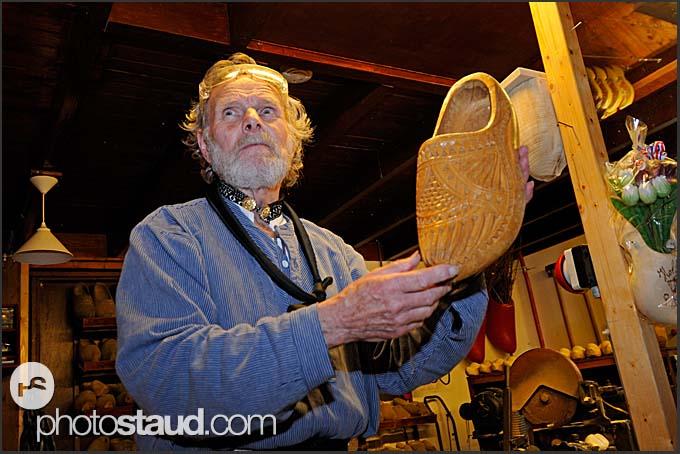 Shoemaker Ben van Woensel shows wooden clog at De Vriendschap in Volendam, Holland, Europe