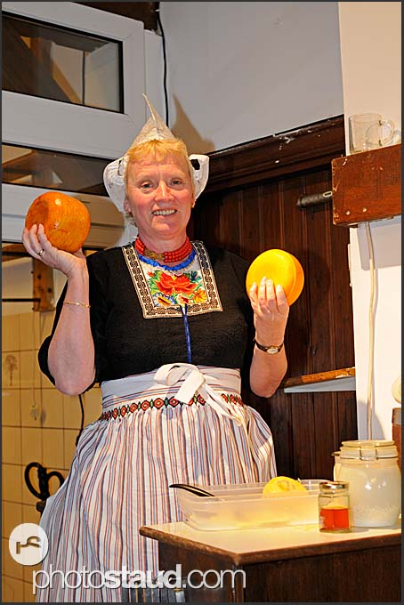 Ria Out presents cheese making at Alida Hoeve, traditional Dutch farm in Volendam, Holland, Europe