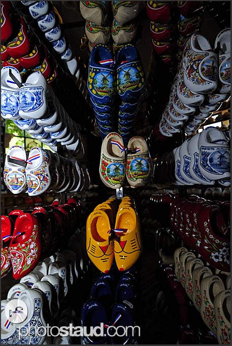 Wooden shoes hanging in souvenir shop at Ratterman traditional Dutch wooden shoemaker, Holland, Europe