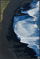 Atlantic Ocean beach of white waves and black volcanic sand, aerial view, southern Iceland