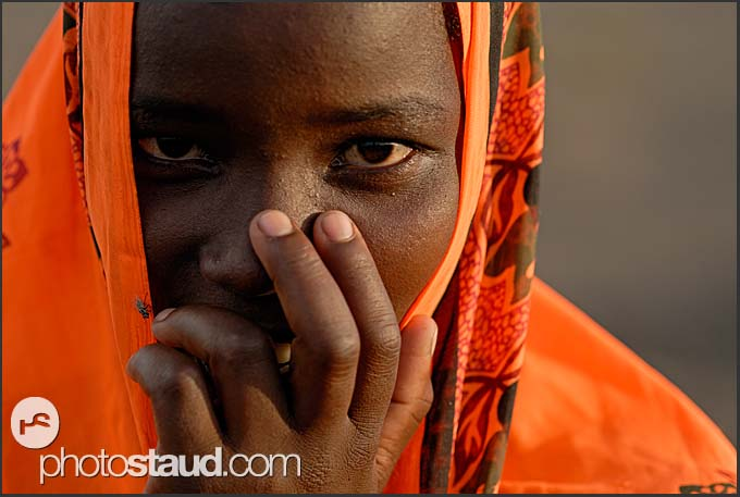 Shy El Molo woman in bright orange blanket, Northern Kenya