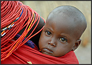 Little El Molo child in mother's arms, El Molo bay of Lake Turkana, Northern Kenya