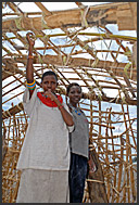 Antonela and Clair building new house on the Lake Turkana shore, Northern Kenya