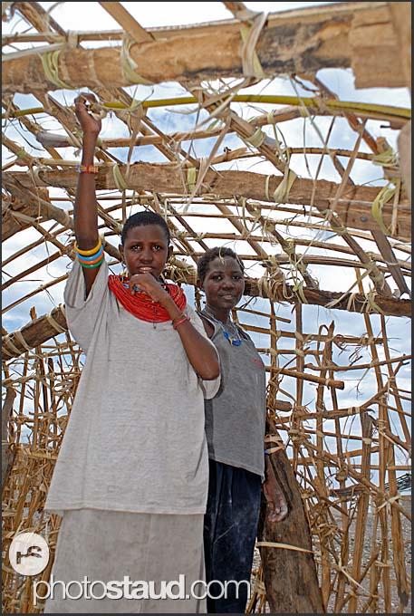 Antonela and Clair building new house on the Lake Turkana shore, Northern Kenya