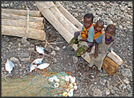 Children of El Molo tribe in their fishing village at the shore of Lake Turkana, Northern Kenya