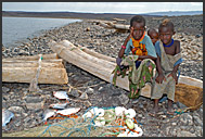 El Molo children with palm tree rafts and morning catch, Lake Turkana, Northern Kenya