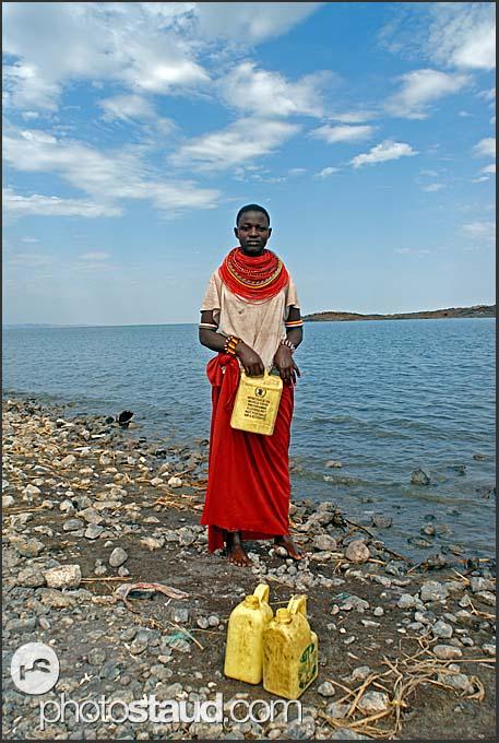 El Molo woman with traditional coloured beads bringing water from Lake Turkana, Northern Kenya