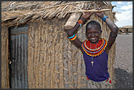 El Molo boy washing up in front of his hut, Lake Turkana, Northern Kenya