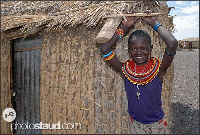 El Molo girl with bead necklaces and padlock key around her neck, Lake Turkana shore, Northern Kenya