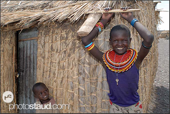 El Molo girl with bead necklaces and padlock key around her neck, Lake Turkana shore, Northern Kenya