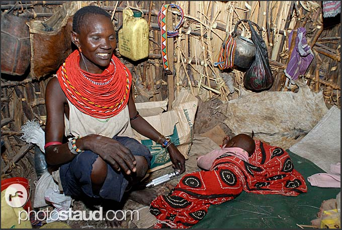 El Molo woman with baby inside her house, El Molo Bay on the shore of Lake Turkana, Northern Kenya