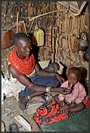 El Molo woman and child inside her house, El Molo Bay on the shore of Lake Turkana, Northern Kenya