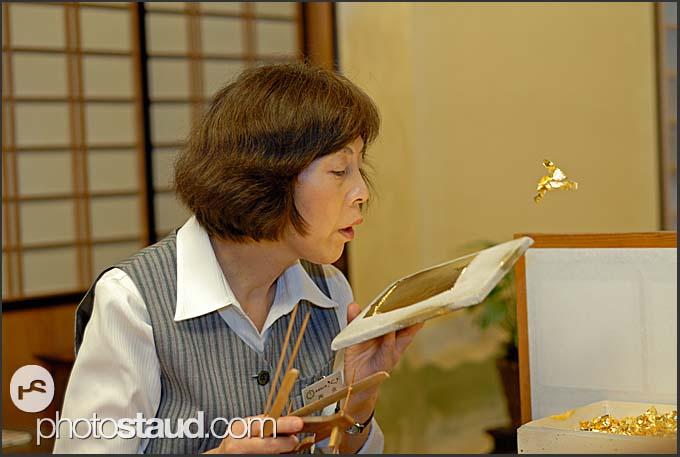 Cutting gold leaves into required size, Kanazawa, Japan