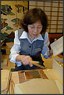 Cutting gold leaves into required size, Kanazawa, Japan