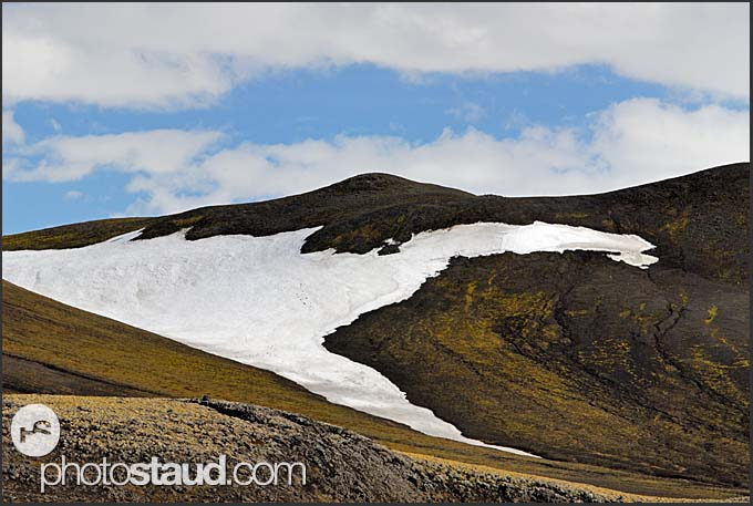 Black lava and snow in the volcanic landscape of Mt. Hekla, Iceland
