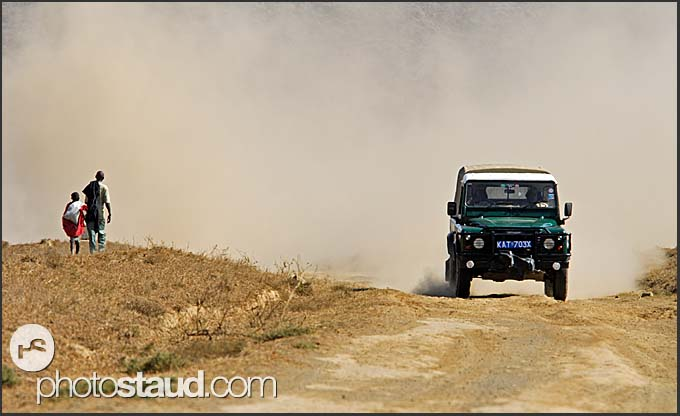 Four WD and walkers on the dusty roads of Hell's Gate National Park, Kenya
