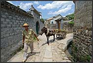 Chinese man with horse carriage, Hongcun village, Anhui, China