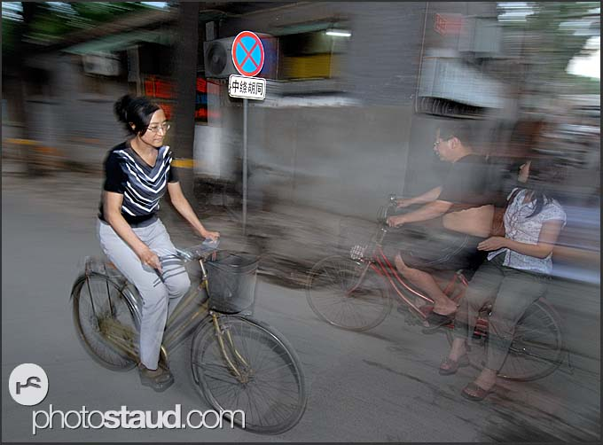 Beijing Hutong in motion – cyclists in the old lanes of Beijing, China