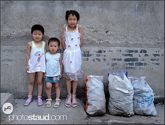 Three and three - Chinese children in Beijing Hutong, China