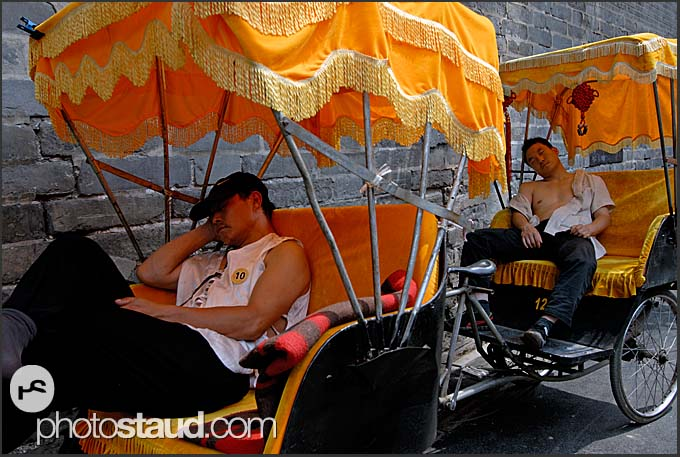 Riders resting in their rickshaws, Beijing Hutong, China