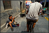 Two Chinese girls playing in the lanes of Beijing Hutongs, China