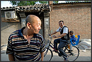 Rickshaw riding in the old streets of Beijing Hutong, China
