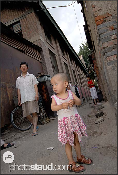 Little Chinese girl in Hutong – the poor quarters of Beijing, China