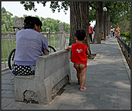 Little Chinese boy in reconstructed hutong area, Beijing, China