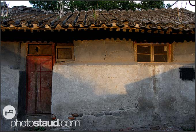 Old houses with traditional roof tiles in Beijing Hutong, China