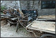Rusting tricycles in a courtyard of Beijing Hutong, China