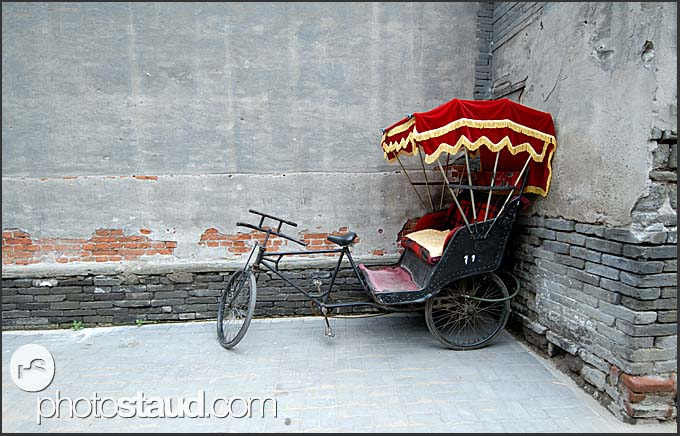 Rickshaw tricycle parked in Beijing Hutong, China