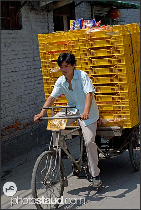 Shop delivery with tricycle in Beijing Hutongs, China