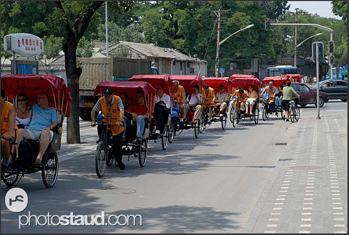 Tourists seeing Beijing Hutong by rickshaw, China