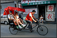 Rickshaw riding in the old streets of Hutong, Beijing, China