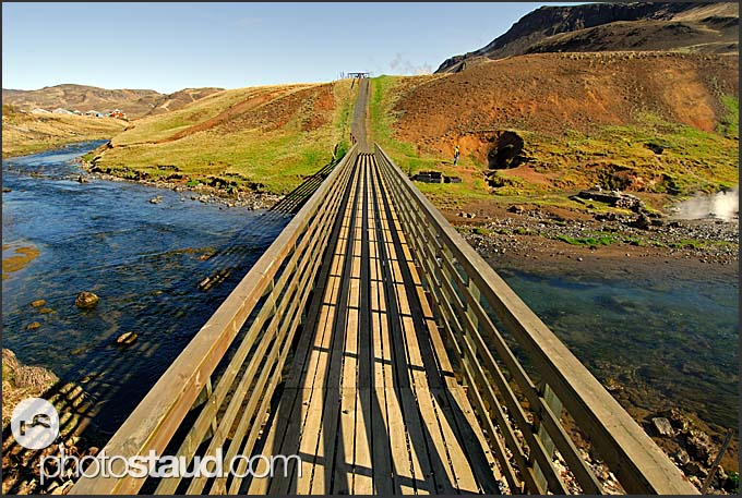 Bridge over Varma River in the colorful landscape of Hveragerdi, Iceland