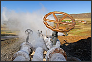 High-pressure steam pipes with guarding valves leading from geothermal power plant, Hveragerdi, Iceland