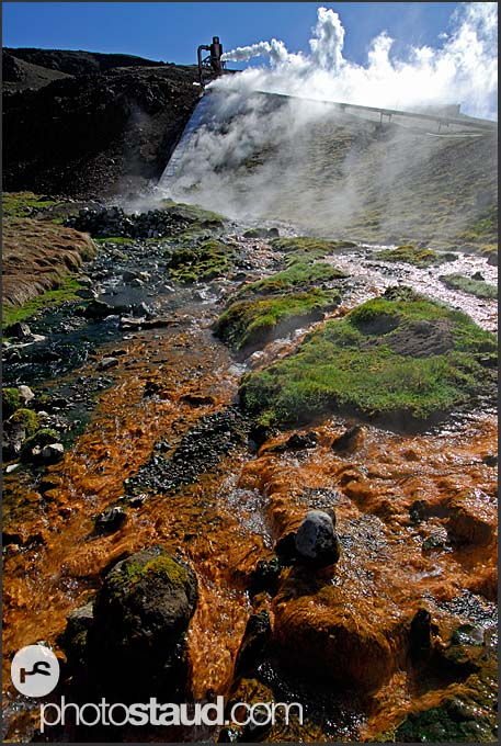 Colored Varma River and geothermal power plant in the Icelandic landscape, Hveragerdi, Iceland