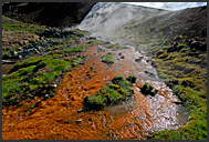 Colored Varma River and steaming hot springs in the Icelandic landscape, Hveragerdi, Iceland