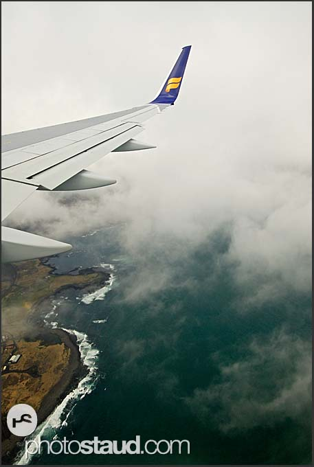 Passenger view from Iceland Air liner flying above the black beaches of South Iceland