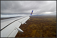 Passenger view from Iceland Air plane shortly before landing in Keflavik, Iceland