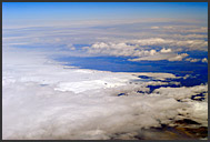 Passenger view of fantastic cloud formations forming bellow aircraft, Iceland