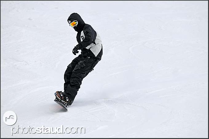 Snowboarder on the slopes of St Caterina, Italy, Europe